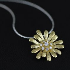 This Silver blossom jewellery adds a fresh finish to a summer tea dress, or a promise of spring during cold, dark, winters days.