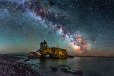 Milky Way Galaxy hovering over Hollow Rock on Lake Superior in Northern Minnesota.