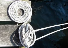 The coil: Without saying a word to the captain, this tells me if he/she respects the art of sailing. I always look for it on a dock. Then I know who's serious. A good sailor would never allow the bitter end to become tangled.