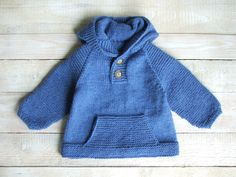 This hoodie will fit toddler boys 18 months to two years old. Hand knitted from bright blue 100% acrylic for easy care.