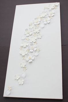 Blank canvas with white flowers from Michael's - this would be cute to paint canvas any color for little girls room