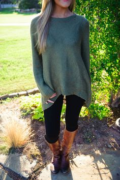 Oversized sweater, leggings, and riding boots