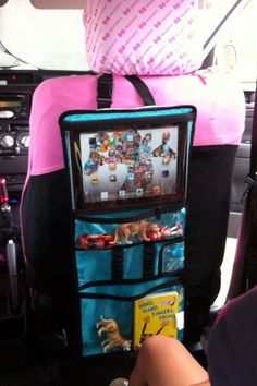 What an awesome way to use the Thirty one timeless beauty bag as an entertainment travel centre for the kids in the back seat!