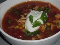 Crock Pot Chicken Tortilla Soup from Food.com:   								I just love coming home from a long day at work to a cooked dinner!  Right when you walk in the door you can smell the wonderful soup, so we dig in as soon as we can!