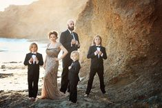 Mar 2019 - A formal family beach portrait with three boys, mom, and dad. All dressed formally in tuxedos and an evening gown for this fine art photography Large Family Photography, Large Family Photos, Family Beach Pictures, Photography Poses, Family Pics, Beach Photos, Family Portraits What To Wear, Summer Family Portraits, Fall Family Photo Outfits