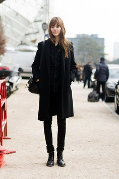 Street style star Freja Beha Erichsen adds a tomboy touch with an all black outfit with work boots