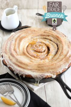 Giant Cast Iron Skillet Cinnamon Roll _ I really love how all those beautiful layers separate ever-so-slightly on the plate. It's irresistible when smothered with orange-zested cream cheese glaze (I swoon!).