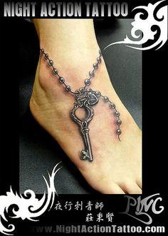 Key tattoo around ankle