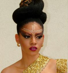 """Gems are used to create a sparkling focal point for this beauty look titled """"Tribal Beauty""""."""