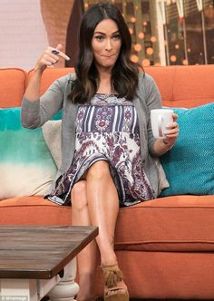 Putting her feet up: Megan, who wore her hair down and sported minimal make-up, is expecti...