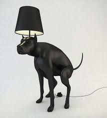 The dog is made from wood. The light on top of the dog is simply connected by a hole. The  stick on the lamp is inserted into a hole that is on top of the dogs head.