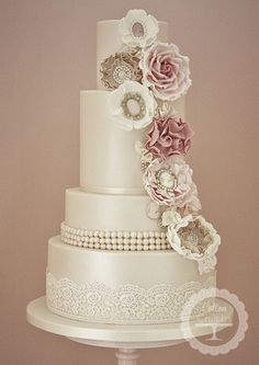 Corsage Cascade from www.cottonandcrumbs.co.uk Please mention that you found them thru Jevel Wedding Planning's Pinterest Account. Keywords: #weddingcakes #weddingcakesunitedkingdom #jevelweddingplanning Follow Us: www.jevelweddingplanning.com www.facebook.com/jevelweddingplanning/