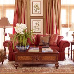 <p>Eye catching artistry inside and out in a mélange of hand-painted vibrancy, delicate latticework and pagoda detailing. Perched atop a dark wood base, the porcelain bowl's intricate desig