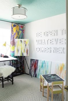How about a 3 dimensional quote for the new space? These cardboard letters can be picked up at Joann Fabric.