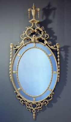"A George III giltwood Robert Adam period 'dressed' oval borderglass mirror Ca1790 England. 87.4""H x 38.98""W."