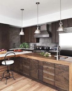 Wall - hand troweled plaster with wax finish. Counters - hand rubbed ebony stain on walnut.