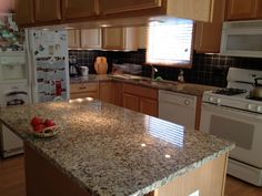 Venetian Gold granite, black travertine backsplash, stainless sink and faucet - our finished project