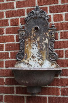 """IMG_3944.JPG European Wall Sink - Baroque  $715.00  I'M SOLD. From Europe, early 1900's. Few styles available. Wonderful on an outdoor fence or chimney with hanging geraniums. This style shown Approx size 36"""" H x 11"""" W x 11"""" Deep.  Prices range from $315 to $715 for more elaborate styles; email us for current inventory pictures to be sent! vintageweave@aol.com"""