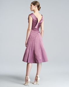 Zac Posen  Duchess Satin Flare Dress  Lustrous duchess silk satin.  Round neckline; V'd back.  Cap sleeves with gathered-into, fold-detailed bust.  Fitted through dropped waist.  Seamed pleats.  Flared, full A-line skirt.  Knee-length.  Hook-and-eye/zip back.  Dry clean.  Made in USA. $2990 very origami