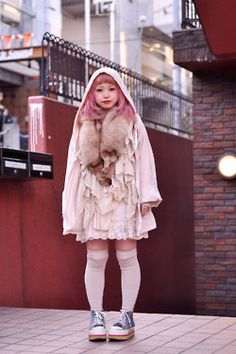 Styling for E. Fox furs and pink wig