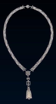 An Art Deco platinum, diamond and black pearl sautoir, by Cartier, circa 1920. #Cartier #ArtDeco #sautoir