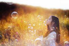 Blow bubbles in a field
