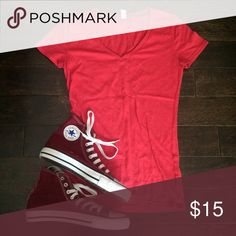 SUPER CUTE RED UNDER ARMOUR VNECK super cute! Only worn a couple of times!!! Great condition. 💟Outfit Inspiration: everyday.  👰Help my fiancé and I save up for our wedding! 📦All purchases are shipped carefully and thoughtfully  🚭Smoke- free home ❗️Bundle to save on SHIPPING & TOTAL  💁Serious and reasonable offers only (no more  than 10% of listing price!)  ✅Suggested User, shop with confidence 🚫NO TRADES 🔁️Sharing is caring Under Armour Tops Tees - Short Sleeve