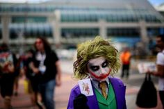 Michaell Cherry shows his Joker costume during Comic Con at the San Diego Convention Center on July 19, 2013 in San Diego, California.  Comic Con International Convention is the world's largest comic and entertainment event and hosts celebrity movie panels, a trade floor with comic book, science fiction and action film-related booths, as well as artist workshops and movie premieres. (Photo by Sandy Huffaker/Getty Images)