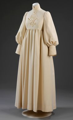 1969 Wedding dress by Jean Muir: Worsted wool twill trimmed with braid, high-waisted with a collar and smock sleeves. Was worn by Lady Pamela Harlech, a former Vogue editor, at her 1969 wedding. The bride wore strips of braid in her hair to match the Celtic design on the front of the dress | VA Museum, London.