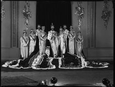 The 1937 Coronation. The Royal Family, in all its magnificence, posed in the Throne Room in Buckingham Palace. After the dramas of the Abdication this scene would doubtless have proved reassuring.An amusing footnote; Maud, Dowager Queen of Norway (right), is totally out-gunned by Queen Mary. Maud used to be very unkind about Queen Mary's rank before marriage ;that of a mere 'Serene Highness'.
