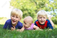 Three Happy Young Siblings: A Young Child, His Little Brother ...