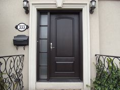 Entry door with one (simply designed) sidelight. Love the wrought iron accents.  Might only work for stucco homes though...???