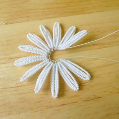 Learn how to make your very own beaded daisies using seed beads and wire! Prior french beading experience is helpful, but not necessary for this tutorial. This is a very fun project for all the bead...