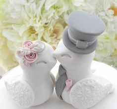 Please read the shop announcement to see my current lead time. https://www.etsy.com/shop/lavagifts This is the most adorable little Lovebird Wedding Cake Topper! These beautiful Lovebirds will add a whole lot of cuteness to your beautiful cake! Simple, elegant and irresistibly cute! She has beautifully sculpted roses and he has an adorable little tie and top hat. Their wings have a beautifully impressed lace design. I can make yours without the hat or with a different hat. Just let me know…