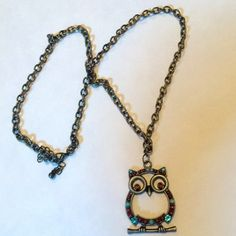 Homemade owl necklace The chain is 11 inches long folded in half the owl is 1 1/2 inches long by 1 inch wide D.k.f.s Jewelry Necklaces