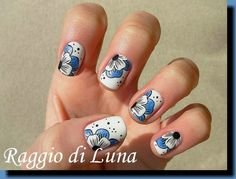 Raggio di Luna Nails: Born Pretty Store review: Stamping plates BP-52 and BP-54 - Floral black pattern on textured red and Blue & white flower on white