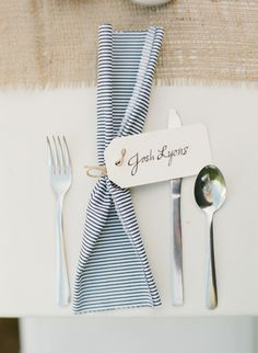 Blue and white table setting for a Coast Guard inspired wedding