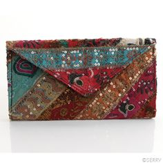 Sari Clutch | www.serrv.org | Dazzling clutch made from strips of repurposed saris, hand sewn and embellished with metallic sequins. Lined interior has single zip pocket, two open pockets, and magnetic snap closure.