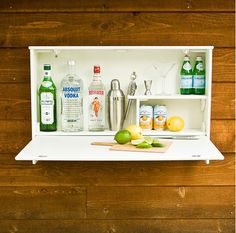 Wall mounted drinks cupboard. Out of reach of children!