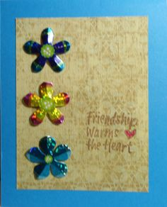 Pretty background on a nice blue card, added some metallic flowers and sentiment...