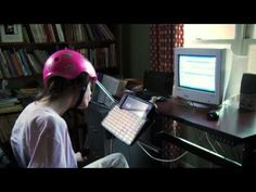 With the use of a stylus tool attached to her helmet, Sarah is able to type and respond to people around the world about Christ.