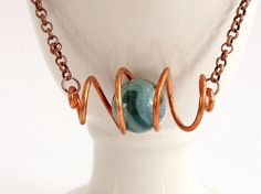 Salvaged copper wire and vintage marble necklace created by Fickle Fox Design Co