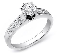 Ladies diamond engagement ring. Contains 0.25 Round cut diamond as center stone. Designed with 0.40ct total princess cut diamonds on the side complimented in 14k gold setting.