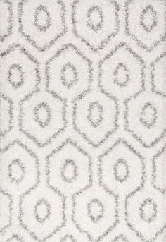 With equal geometric keyhole patterns, this easy shag rug is 100 percent polypropylene and machine-made making it easy to clean and durable. This rug has a soft plush pile and will bring the comfortable look to your interiors.