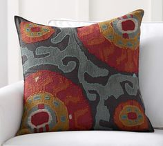 "Houston Cropped Suzani Pillow Cover | Pottery Barn / $79.50 / 24"" square / 100% cotton, button closure / ""The sun motif in traditional suzanis from Central Asia signified life and vitality. Our more contemporary update enlarges the pattern for a bold, eye-catching look."""