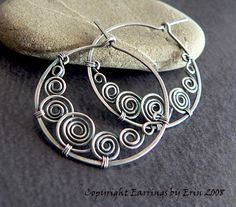 wire spiral earrings, each spiral comes from behind the one to the right of it