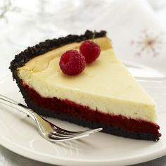 Red Velvet Cheesecake from McCormick.com ~ This cheerful double layer cheesecake is an indulgent new take on the traditional Red Velvet Cake.