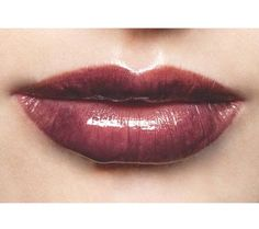 """Try a burgundy lip stain  Think of burgundy as red's hipper younger sister. """"Like red, it's seductive and feminine, but it's more mysterious,"""" says makeup artist Jillian Dempsey, Avon's global creative color director. Use a lip stain because it will last longer."""