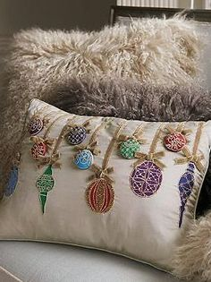 Bring sophisticated Christmas cheer to your seating space with the Ornament Decorative Pillow that features various fabrics, embroidery and beads.