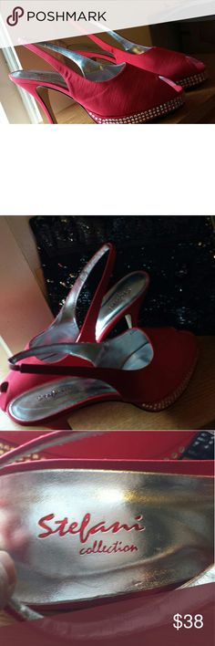 Stefani high heels Red 4 1/2 in heels with decorative jewels on platform. They are new, tag is on bottom Stefani Shoes